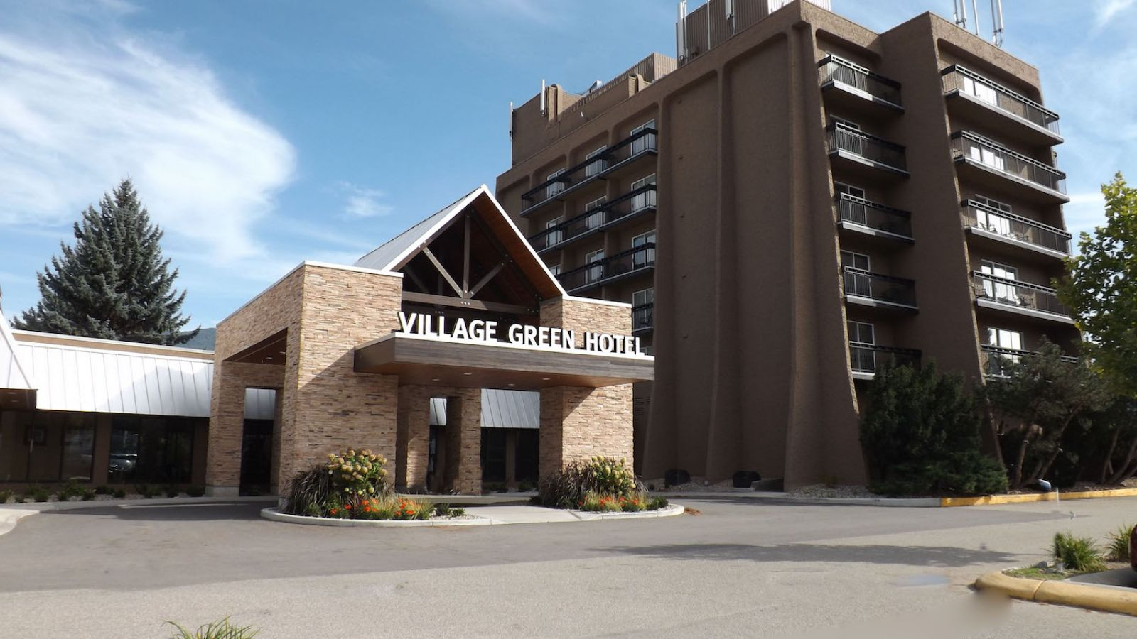 Front View of the Village Green Hotel Vernon
