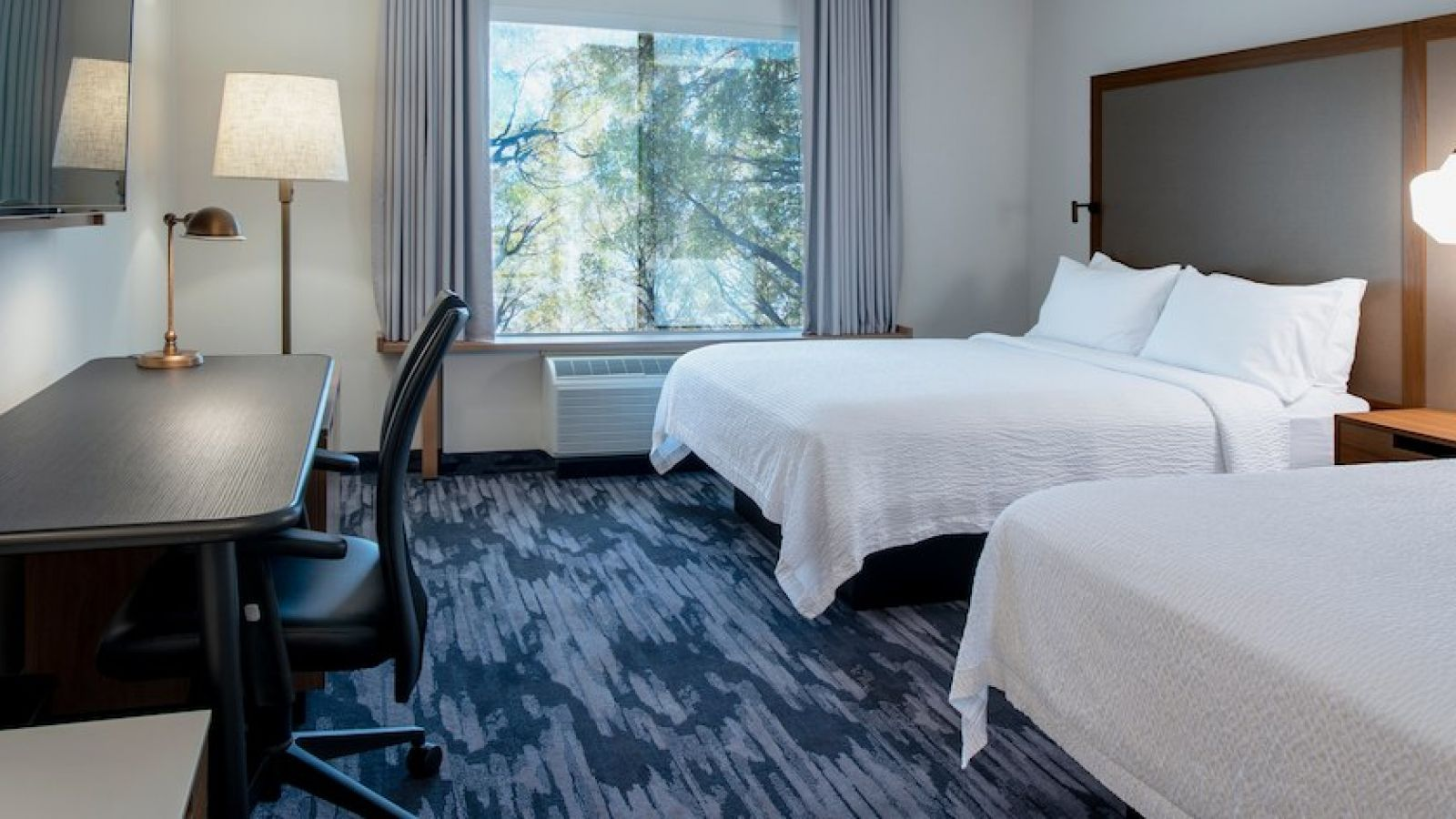 Our newly renovated queen/queen guest room features complimentary Wi-Fi, a large flat-screen TV and a functional work space