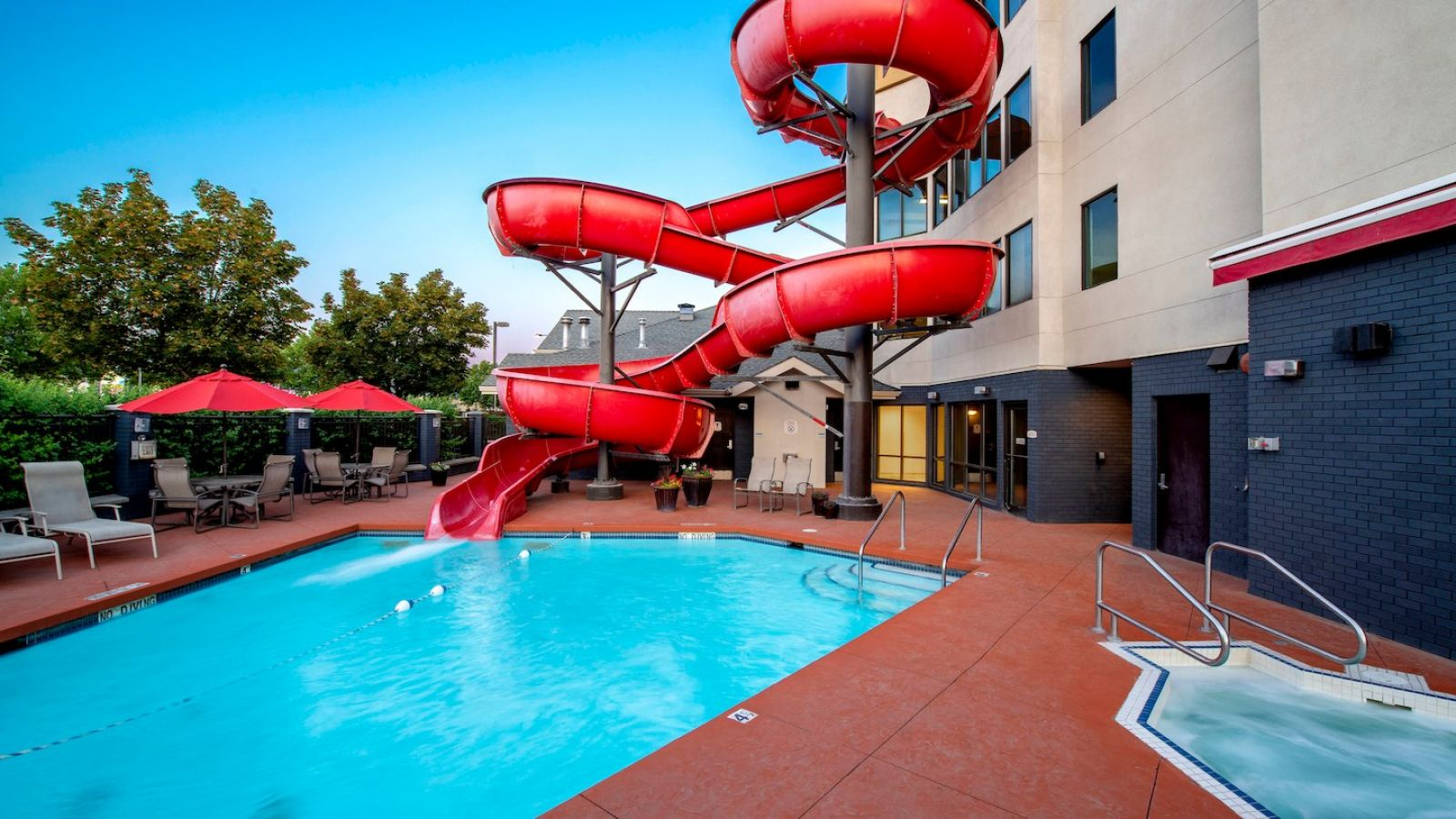 Our heated outdoor pool features a four-story waterslide.